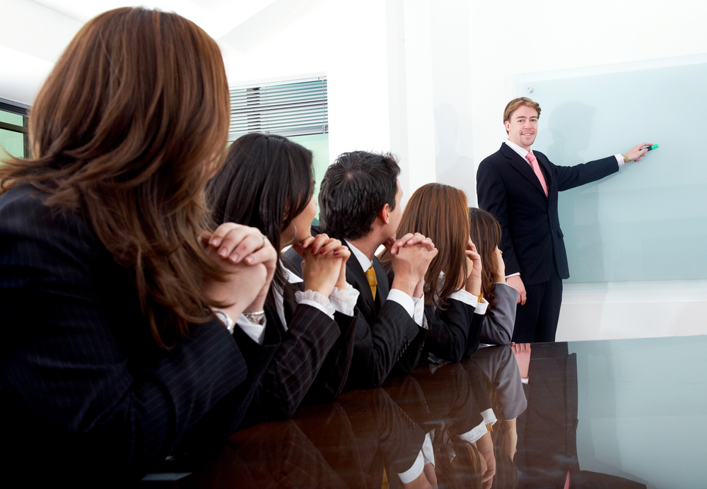 business meeting in an office with a man doing a presentation