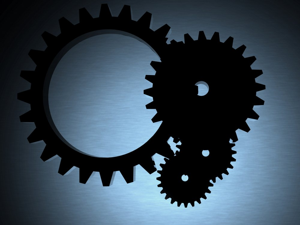 engineering cogwheels backlit over a metal texture - 3d render